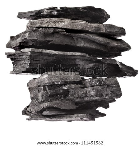 stack tower of black coal isolated on white background - stock photo