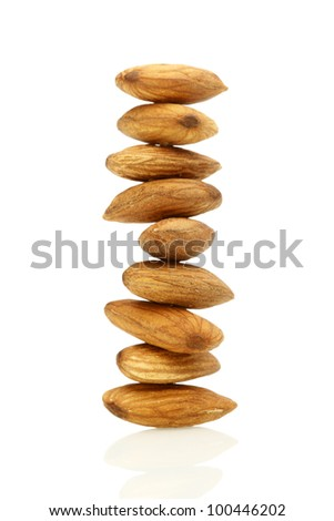 Stacked Almond Nuts on White Background - stock photo
