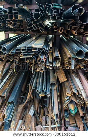 Stacked aluminum metal pipes. Heavy industry production, iron scrap material for recycle in Store Close up a lot of different building material from iron.
