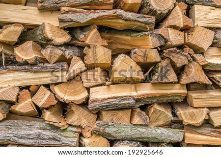 Stacked and chopped wood for fires - stock photo