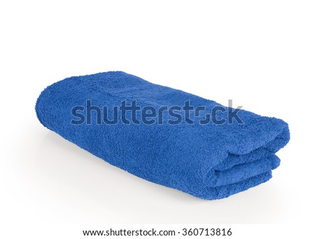 Stacked blue towel spa cloth beach towels isolated on white background. Thai has clipping path. - stock photo