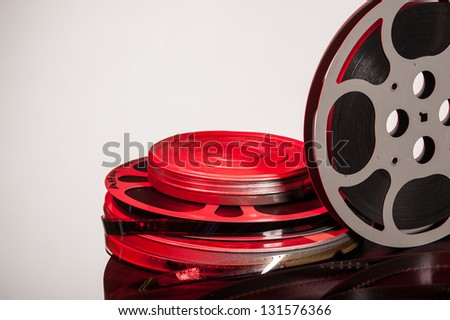stacked canisters of movie film with film reel - film festival concept - stock photo