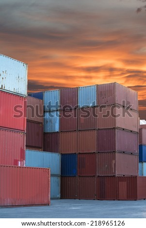 Stacked cargo containers in import export logistic area of freight sea port terminal - stock photo