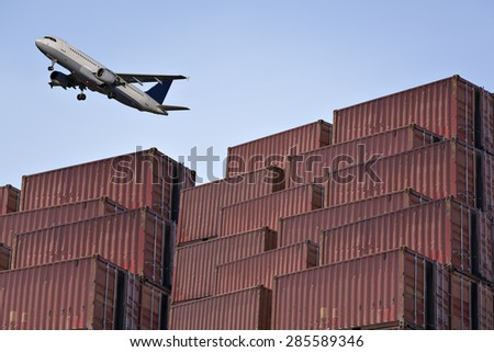 Stacked cargo containers in Logistic Zone - stock photo