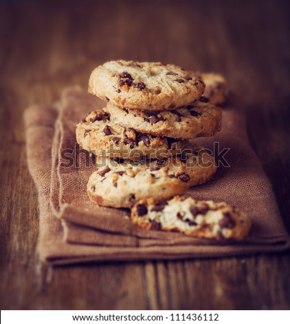 Stacked chocolate chip cookies on brown napkin - stock photo