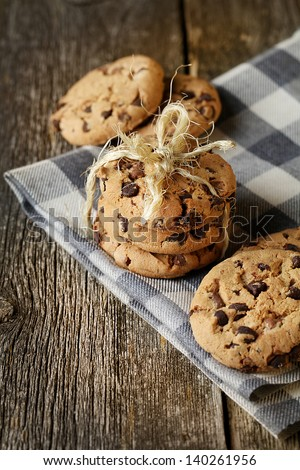 Stacked chocolate chip cookies on napkin - stock photo