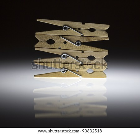 Stacked clothespins - stock photo