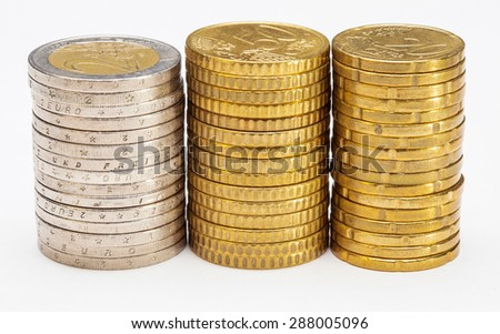Stacked coins - side view of columns of euro coins on white  background - stock photo