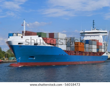 Stacked colorful containers on a ship deck - stock photo