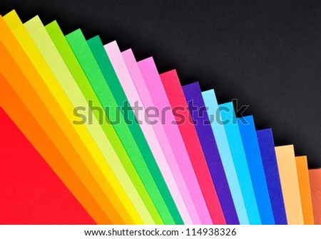 Stacked colorful paper for background - stock photo