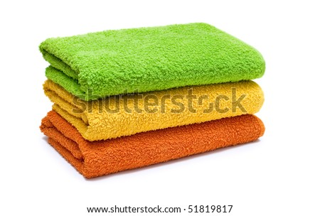 Stacked colorful towels isolated on a white background.