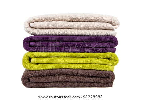 stacked colorful towels on a white backgroun - stock photo