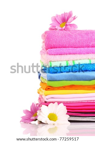 stacked colorful towels on a white background - stock photo