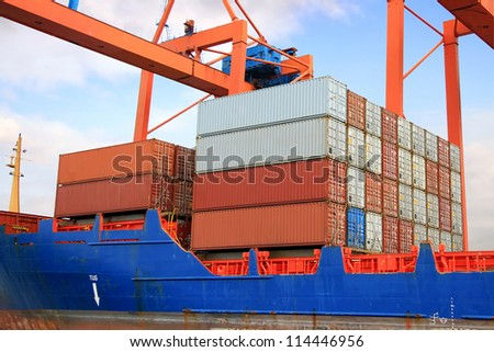 Stacked containers on ship deck - stock photo