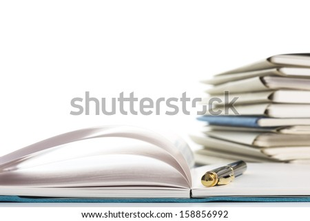 Stacked files and notebook.On white background. - stock photo