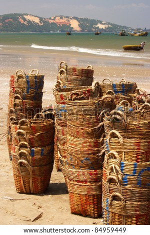 Stacked fishing baskets on Mui Ne beach in Vietnam South East Asia - stock photo