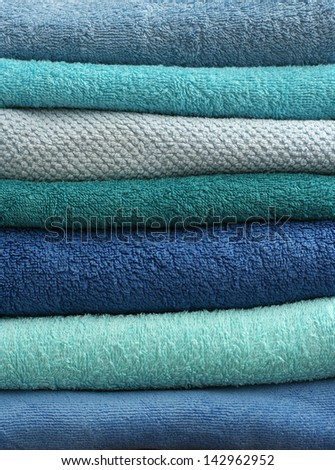 stacked light blue and turquoise bath towels texture - stock photo