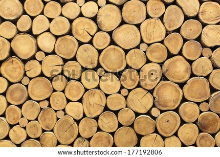 Stacked logs wall texture using as background