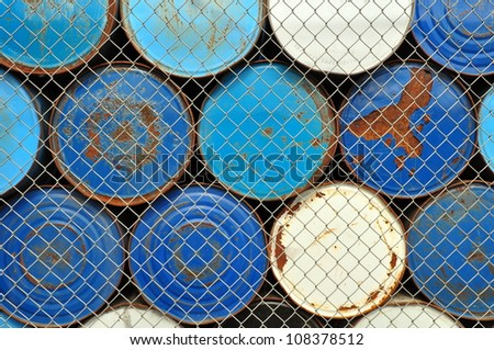 Stacked metal barrels - stock photo