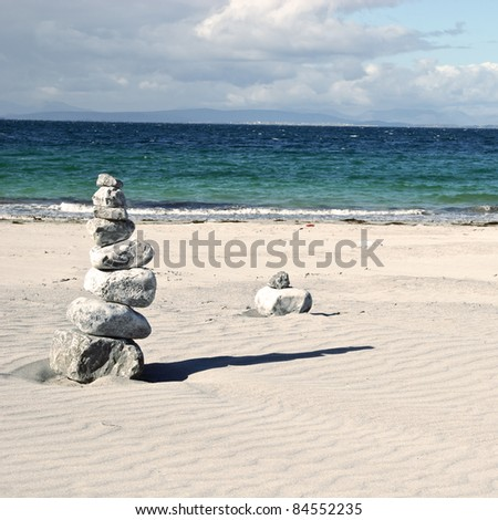 stacked pebbles on the beach - stock photo