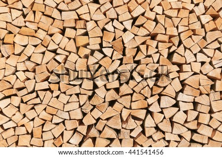 Stacked pieces of wood for background or texture; Woodpile; Wood processing; Storage of fire wood; Heat generation - stock photo