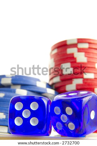 Stacked poker chips and blue dice on white