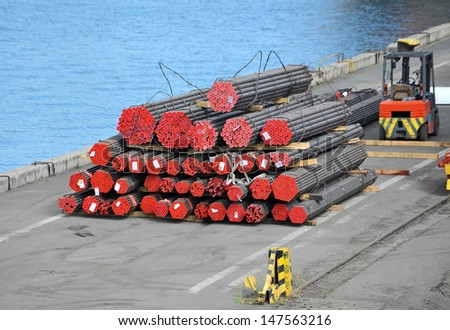 Stacked PVC and steel pipe ready for shipment - stock photo