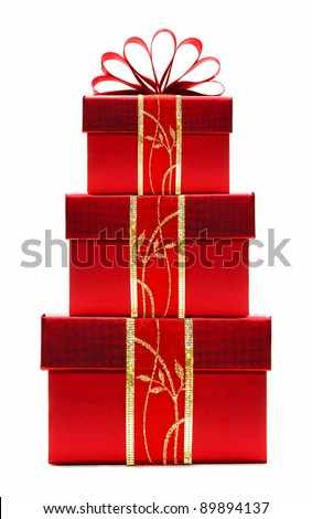 Stacked red Christmas gift boxes with ribbon and bow isolated on a white background - stock photo