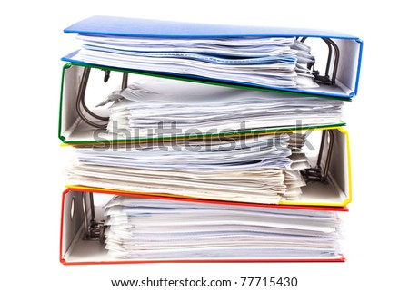 Stacked red, green, blue and yellow office folders  isolated on white background