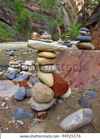 Stacked rocks in balance along river