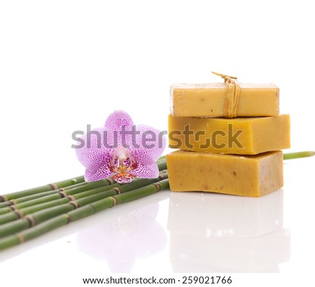 Stacked Soap and pink orchid with bamboo grove