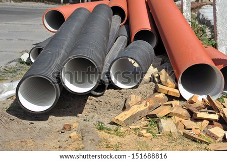 Stacked some PVC pipe on construction site - stock photo