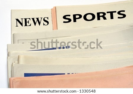 Stacked sports newspapers on white background