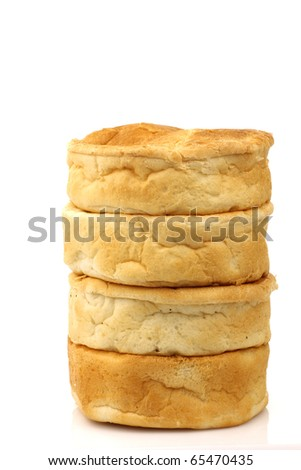 stacked traditional Dutch bread on a white background