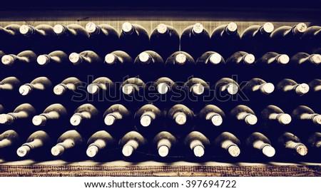 Stacked up wine bottles - stock photo