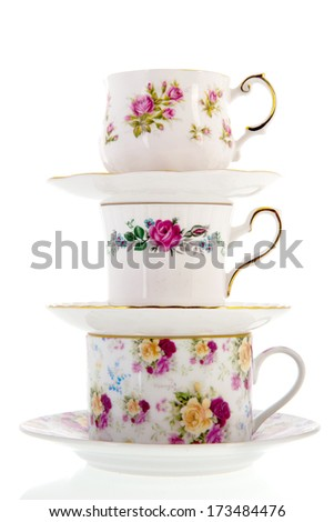 stacked vintage coffee or tea cups isolated over white background - stock photo