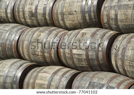 stacked whiskey barrels - stock photo