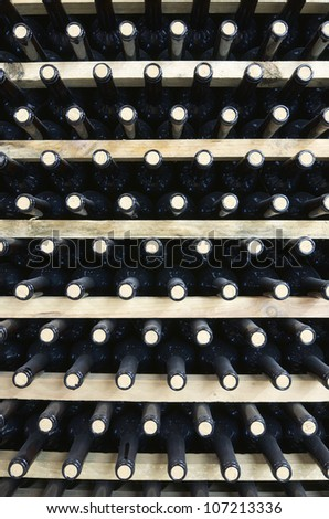 stacked wine bottles to ferment the wine, La Rioja, Spain - stock photo