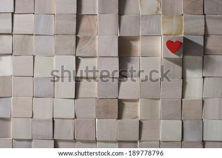 Stacked wooden brick with heart - stock photo
