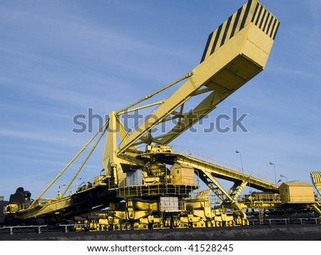 Stacker- reclaimer at coal terminal - stock photo