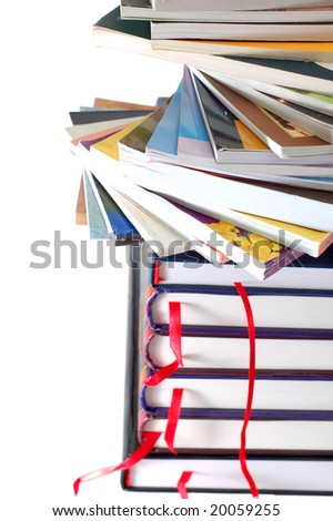 stacking soft and hardcover books