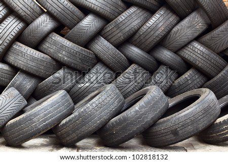 Stacking wheels used in a workshop/Wheel recycling - stock photo