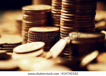 Stacks and heaps of coins - stock photo