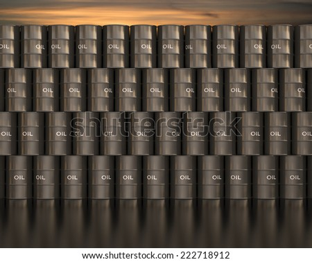 Stacks barrel of oil with sunset in the background.