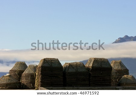 Stacks of Alaskan crab pots in Hoonah Icy Straight Point - stock photo