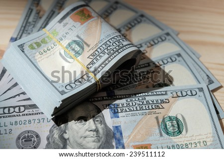 Stacks of american money / studio photography of US banknotes - on wooden background. 100 dollar bills close up. - stock photo