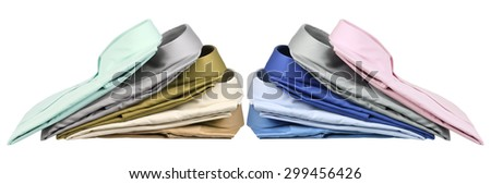 Stacks of Business Shirts on White Background - stock photo