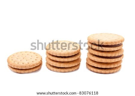 Stacks of chocolate filled cookies on white background