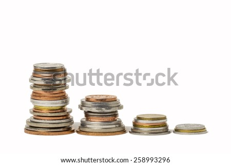 Stacks of coins from around the world. - stock photo