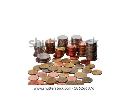 stacks of coins isolated on a white background. - stock photo
